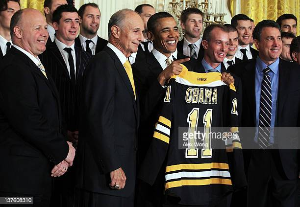 S President Barack Obama poses for photos with members of the Boston Bruins head coach Claude Julien team owner Jeremy Jacobs Jacobs' son Charlie...