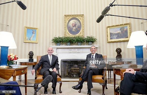 S President Barack Obama poses with Afghan President Ghani during a restricted bilateral meeting in the Oval Office of the White House March 24 2015...