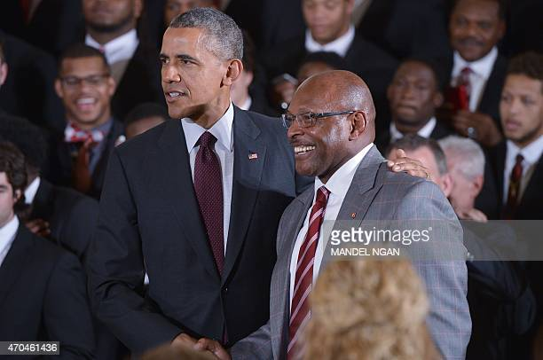 US President Barack Obama poses with former football player Archie Griffin during an event in honor of the 2015 college football playoff national...