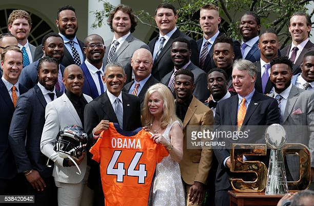 US President Barack Obama poses with the 50th Super Bowl Champion Denver Broncos in the Rose Garden of the White House in Washington on June 6 2016 /...