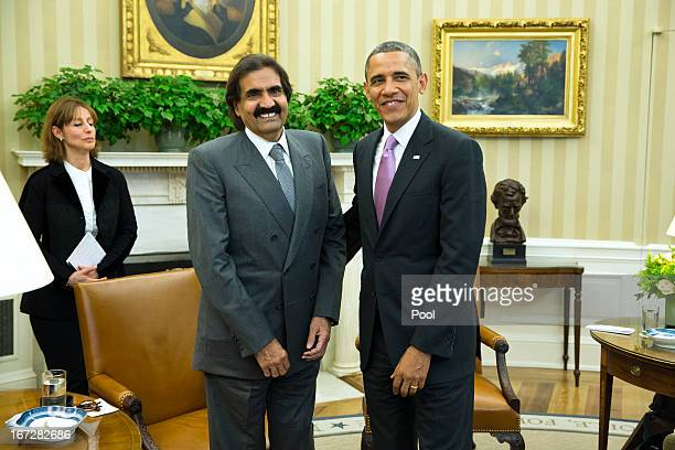 US President Barack Obama poses with the Emir of Qatar Hamad bin Khalifa alThani during a presser in the Oval Office of the White House April 23 2013...