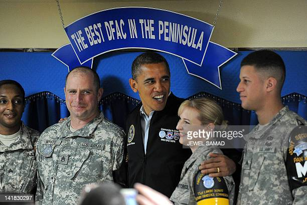 US President Barack Obama poses with US soldiers at army base Camp Bonifas in Paju during a visit to the Demilitarized Zone on the border between...