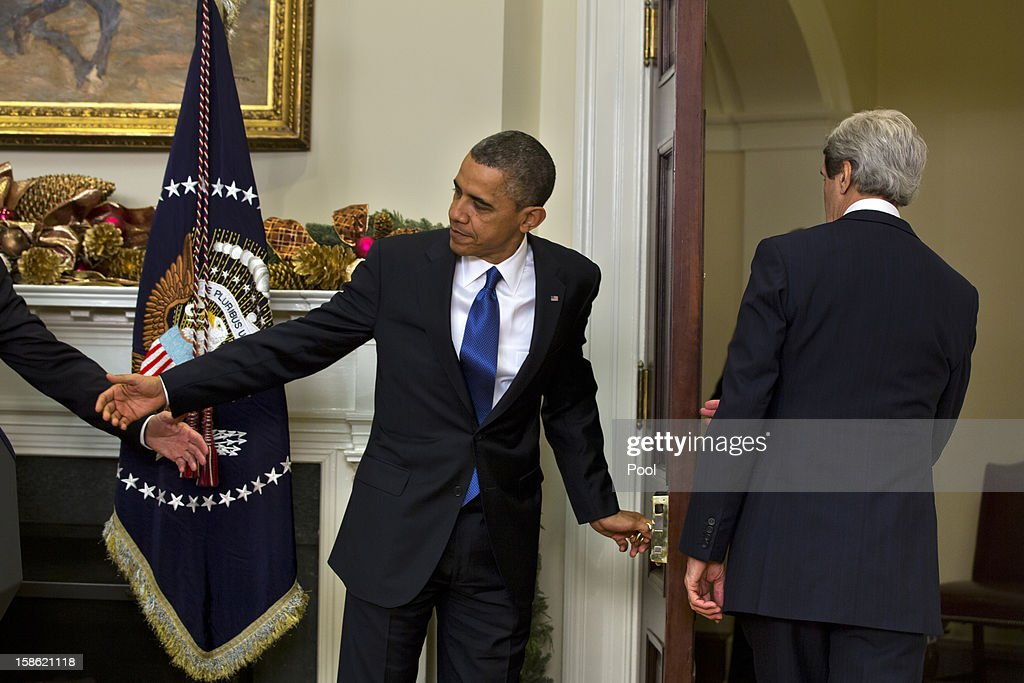 U.S. President Barack Obama (L) prepares to follow Sen. John Kerry (D-MA) out the door of the Roosevelt Room after nominating him to be the next Secretary of State at the White House December 21, 2012 in Washington, DC. If confirmed, Kerry will replace retiring Secretary of State Hillary Clinton early in 2013.