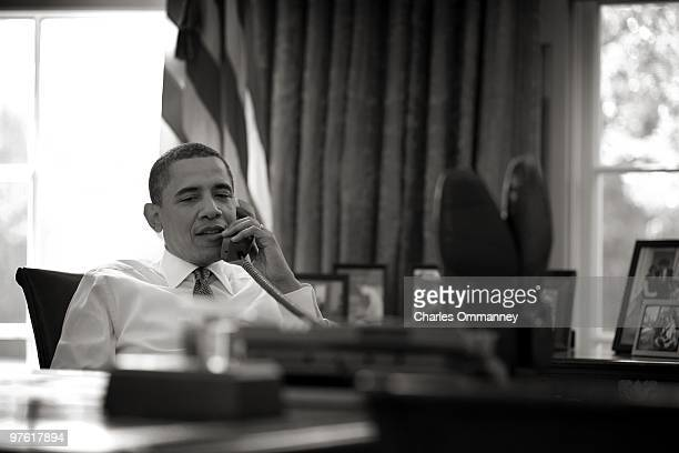 S President Barack Obama prepares to make a statement after trilateral talks with Afghan President Hamid Karzai and Pakistani Prime Minister Asif Ali...
