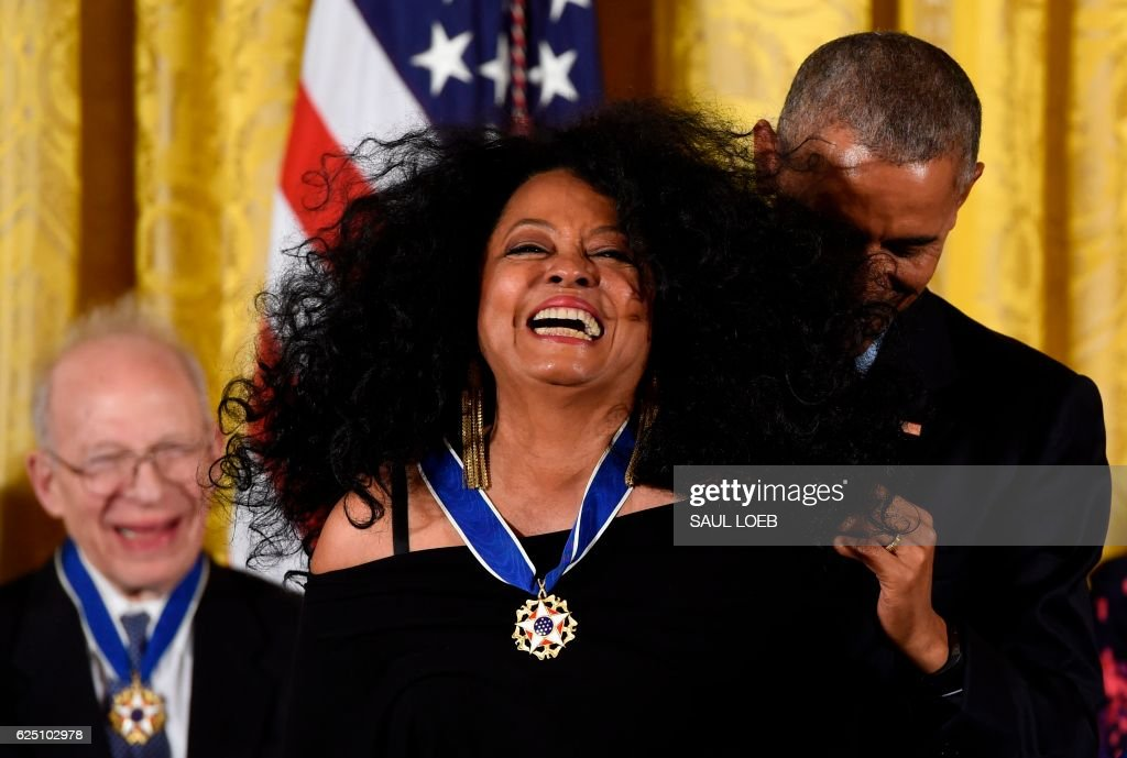 US President Barack Obama prepares to present singer Diana Ross with the Presidential Medal of Freedom, the nation's highest civilian honor, during a ceremony honoring 21 recipients, in the East Room of the White House in Washington, DC, November 22, 2016. /