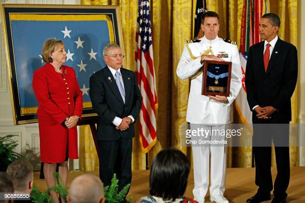 S President Barack Obama prepares to present the Medal of Honor to Paul and Janet Monti on behalf of their son US Army Sergeant First Class Jared C...