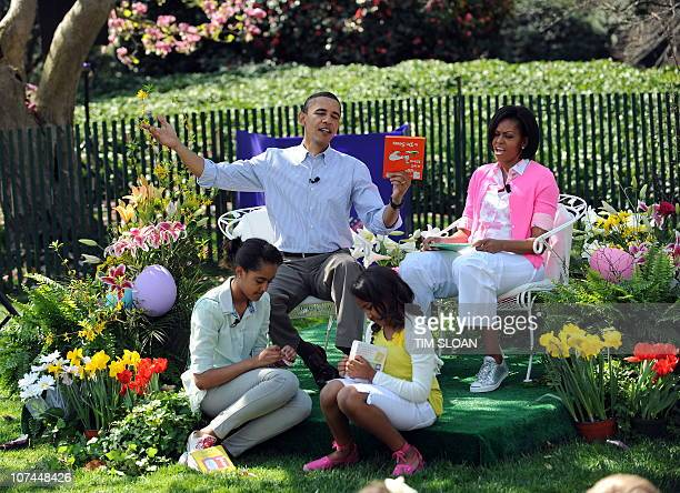 US President Barack Obama prepares to read Green Eggs and Ham with First Lady Michelle Obama Malia and Sasha on the South Lawn of the White House...