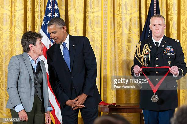 S President Barack Obama presents a 2012 National Humanities Medal to former Poet Laureate of the United States Kay Ryan during a ceremony in the...