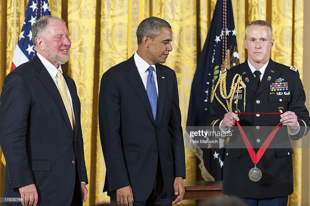 U.S. President Barack Obama (C) presents a 2012 National Humanities Medal to political scientist and professor Robert Putnam (L) during a ceremony in the East Room of the White House on July 10, 2013 in Washington, DC. Putnum is recognized for deepening our understanding of community in America.