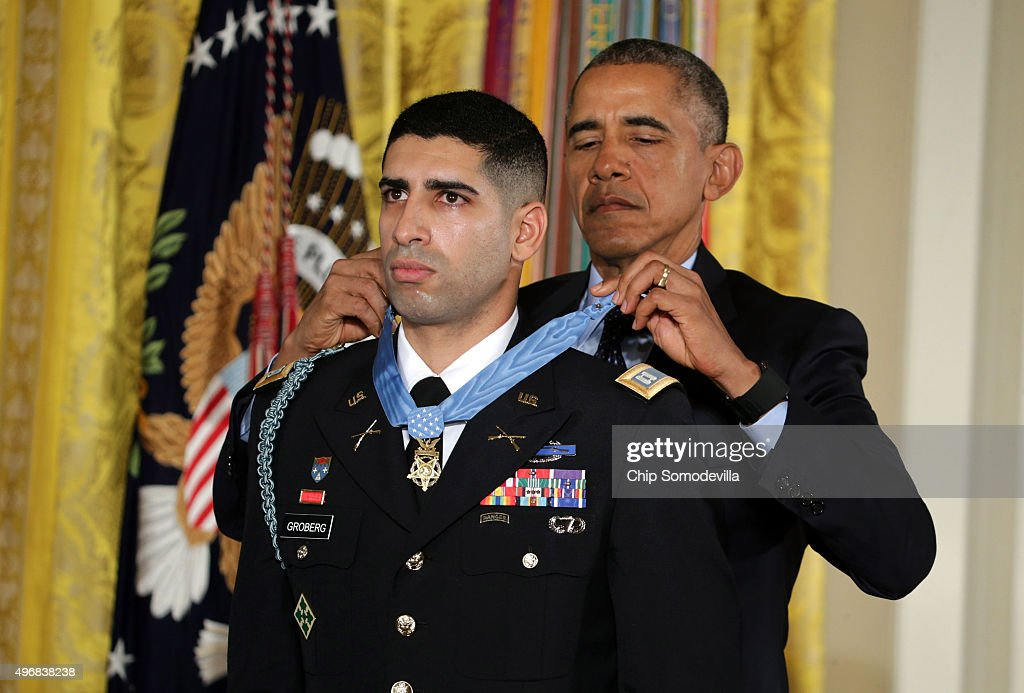 U.S. President Barack Obama presents a Medal of Honor for conspicuous gallantry to Army Captain Florent A. Groberg (Ret.) during an East Room ceremony at the White House November 12, 2015 in Washington, DC. Captain Groberg received the Medal of Honor for attempting to push a suicide bomber away from harming his patrol while serving as a Personal Security Detachment Commander for Task Force Mountain Warrior, 4th Infantry Brigade Combat Team, 4th Infantry Division during combat operations in Asadabad, Kunar Province, Afghanistan on August 8, 2012. He was severely injured from his courageous actions.