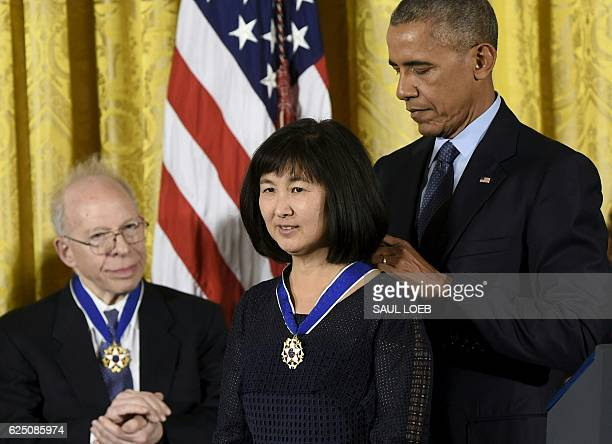 US President Barack Obama presents artist and designer Maya Lin with the Presidential Medal of Freedom the nation's highest civilian honor during a...