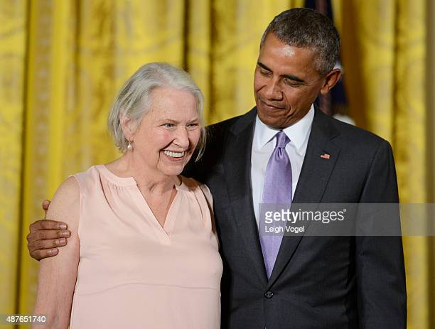 President Barack Obama presents author Annie Dillard with the 2014 National Humanities Medal at The White House on September 10 2015 in Washington DC