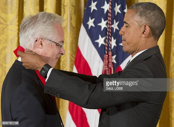 US President Barack Obama presents author Louis Menand with the 2015 National Humanities Medal during a ceremony in the East Room of the White House...