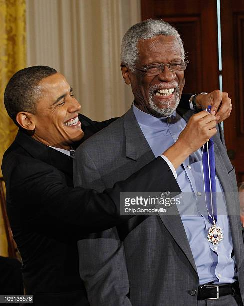 S President Barack Obama presents Basetball Hall of Fame member and human rights advocate Bill Russell the 2010 Medal of Freedom in the East Room of...