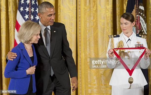 US President Barack Obama presents historian and author Elaine Pagels with the 2015 National Humanities Medal during a ceremony in the East Room of...