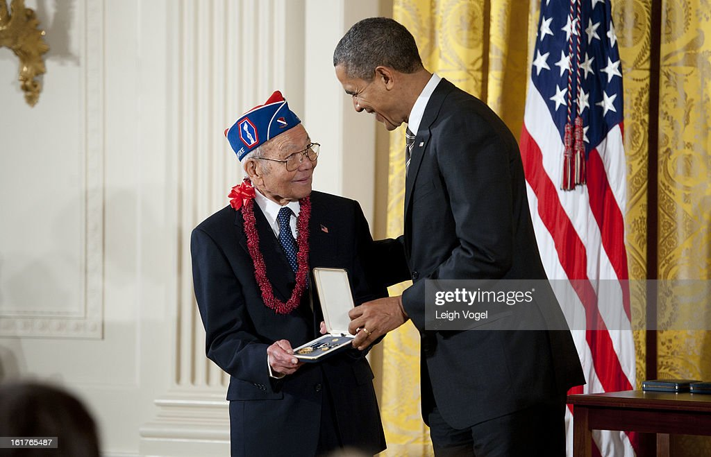 President Barack Obama presents Japanese American Veterans Association Executive Director Terry Shima with the 2012 Presidential Citizens Medal at the White House on February 15, 2013 in Washington, DC.