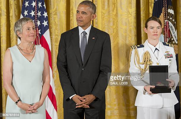 US President Barack Obama presents Jody Lewen Executive Director of the Prison University Project at San Quentin State Prison in California with the...
