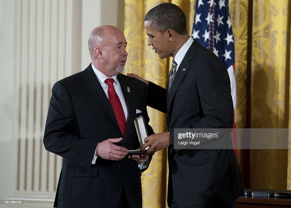 President Barack Obama presents Military Missions in Action founder Michael Dorman with the 2012 Presidential Medal at the White House on February 15, 2013 in Washington, DC.