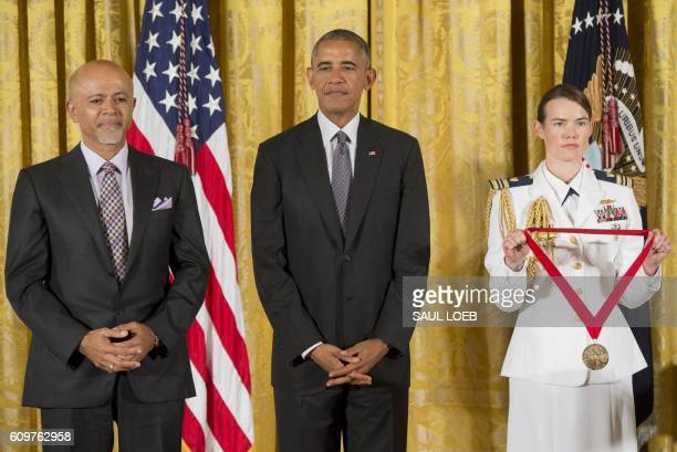 US President Barack Obama presents physician and author Abraham Verghese with the 2015 National Humanities Medal during a ceremony in the East Room...