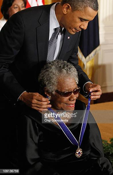 President Barack Obama presents poet and author Maya Angelou with the 2010 Medal of Freedom in the East Room of the White House February 15, 2011 in...