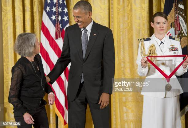 President Barack Obama presents poet Louise Gluck with the 2015 National Humanities Medal during a ceremony in the East Room of the White House in...