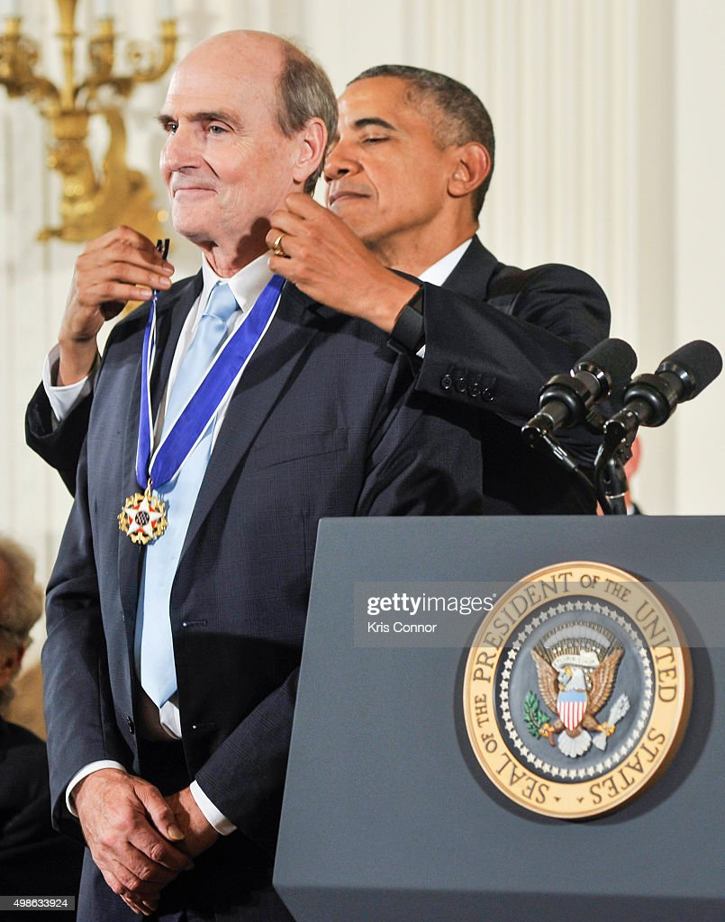 President Barack Obama presents recording artist James Taylor with the Presidential Medal of Freedom during the 2015 Presidential Medal Of Freedom ceremony at the White House on November 24, 2015 in Washington, DC.