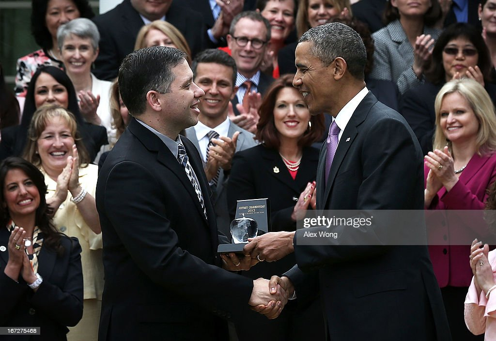 U.S. President Barack Obama (R) presents the 2013 National Teacher of the Year award to recipient Jeff Charbonneau, a high school science teacher from Zillah, Washington, during a Rose Garden event at the White House April 23, 2013 in Washington, DC. President Obama held the event to honor the 2013 National Teacher of the Year and finalists for their hard work and dedication in the classroom.