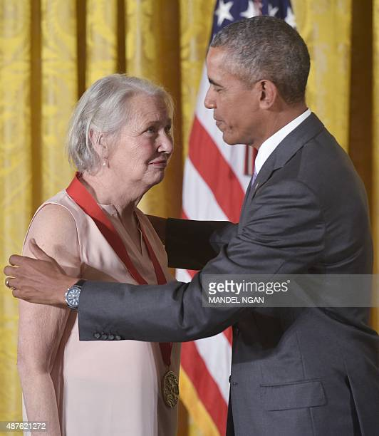 US President Barack Obama presents the 2014 National Humanities Medal to author Annie Dillard during a ceremony in the East Room of the White House...