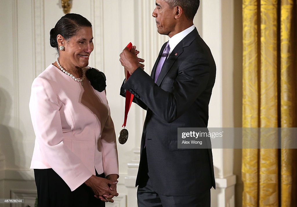 U.S. President Barack Obama (R) presents the 2014 National Humanities Medal to Evelyn Brooks Higginbotham (L) during an East Room ceremony at the White House September 10, 2015 in Washington, DC. Evelyn Brooks Higginbotham was honored for illuminating the African-American journey in her writings and edited volumes.