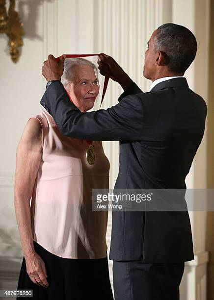 S President Barack Obama presents the 2014 National Humanities Medal to Annie Dillard during an East Room ceremony at the White House September 10...