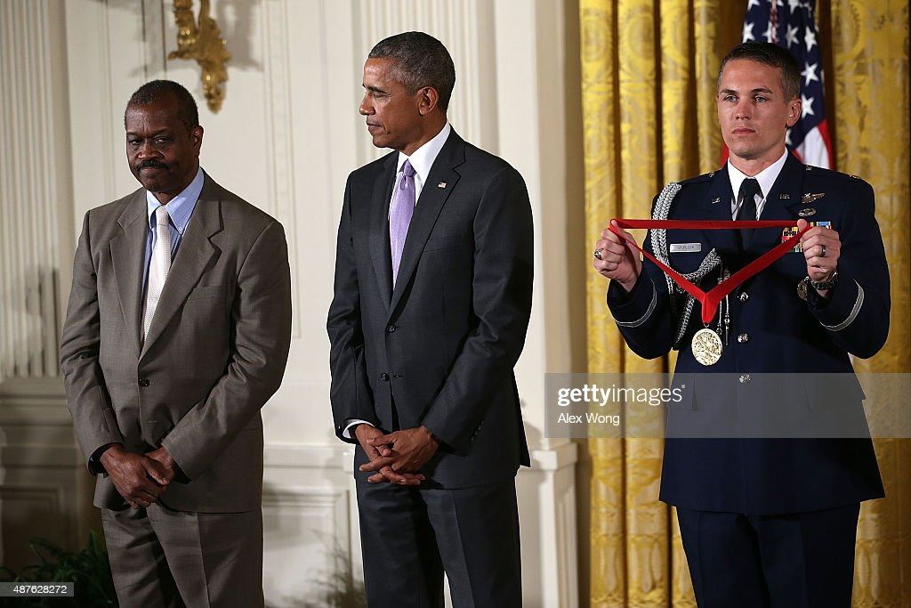 U.S. President Barack Obama (2nd L) presents the 2014 National Humanities Medal to Everett L. Fly (L) during an East Room ceremony at the White House September 10, 2015 in Washington, DC. Everett L. Fly was honored for preserving the integrity of African-American places and landmarks.