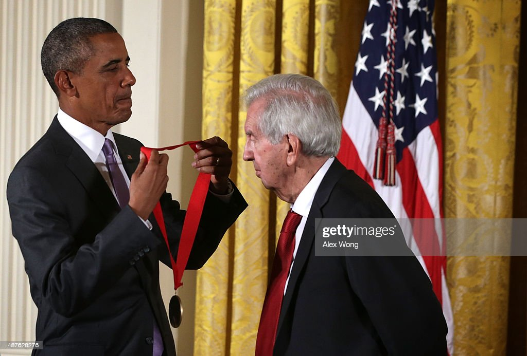U.S. President Barack Obama (L) presents the 2014 National Humanities Medal to Larry McMurtry during an East Room ceremony at the White House September 10, 2015 in Washington, DC. Larry McMurtry was honored for his books, essays, and screenplays.