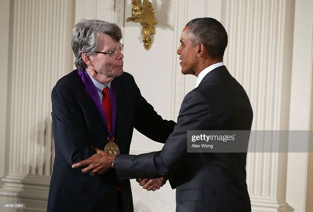 U.S. President Barack Obama (R) presents the 2014 National Medal of Arts to Stephen King (L) during an East Room ceremony at the White House September 10, 2015 in Washington, DC. Stephen King was honored for his contributions as an author.