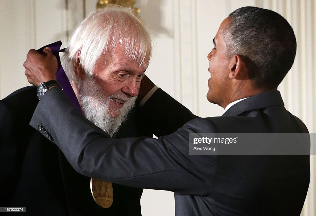 U.S. President Barack Obama (R) presents the 2014 National Medal of Arts to John Baldessari (L) during an East Room ceremony at the White House September 10, 2015 in Washington, DC. John Baldessari was honored for his contributions as a visual artist.