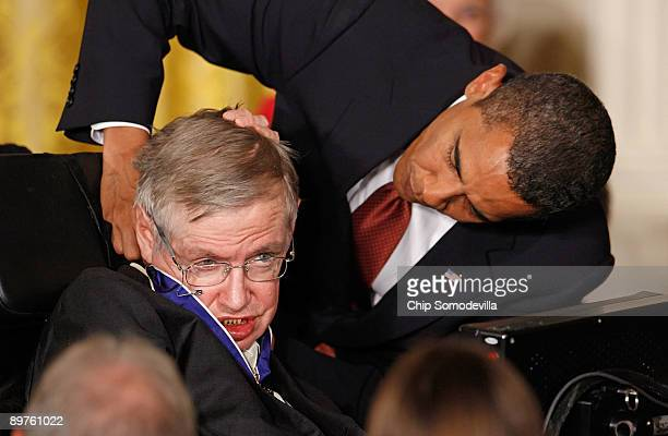 S President Barack Obama presents the Medal of Freedom to physicist Stephen Hawking during a ceremony in the East Room of the White House August 12...
