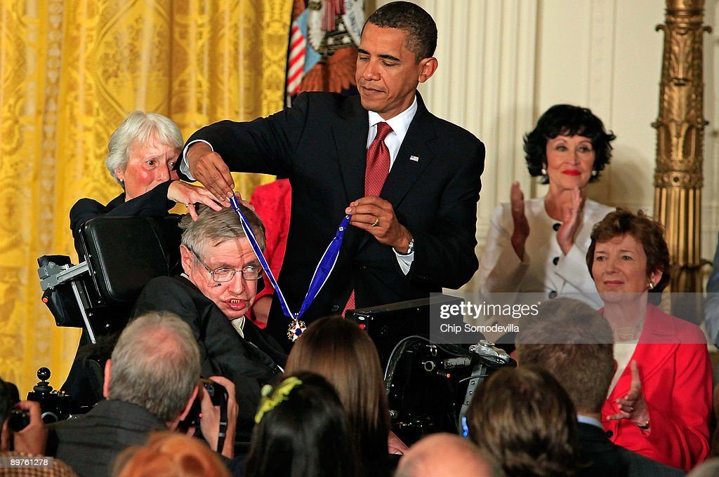 U.S. President Barack Obama (R) presents the Medal of Freedom to physicist Stephen Hawking during a ceremony in the East Room of the White House August 12, 2009 in Washington, DC. Obama presented the medal, the highest civilian honor in the United States, to 16 recipients during the ceremony.