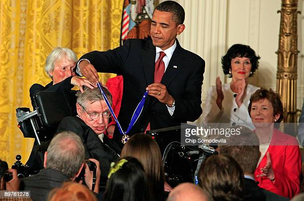 President Barack Obama presents the Medal of Freedom to physicist Stephen Hawking during a ceremony in the East Room of the White House August 12,...