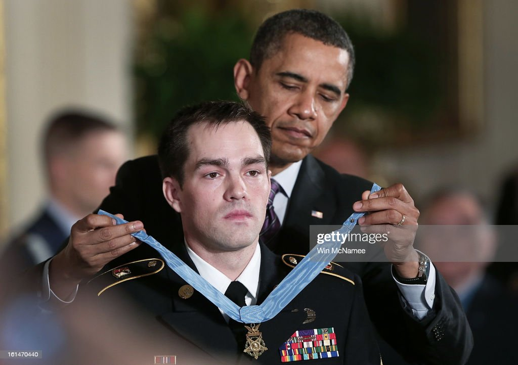 U.S. President Barack Obama (R) presents the Medal of Honor for conspicuous gallantry to Clinton Romesha (L), a former active duty Army Staff Sergeant, at the White House February 11, 2013 in Washington, DC. Romesha received the Medal of Honor for actions during combat operations against an armed enemy at Combat Outpost Keating, Kamdesh District, Nuristan Province, Afghanistan on October 3, 2009.