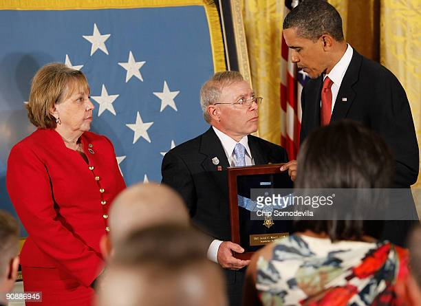 S President Barack Obama presents the Medal of Honor to Paul and Janet Monti on behalf of their son US Army Sergeant First Class Jared C Monti during...