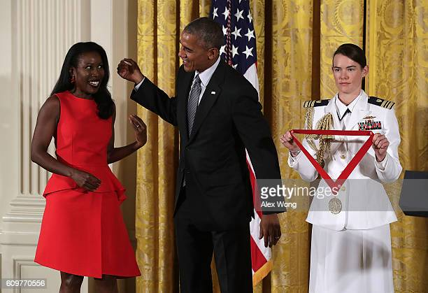 S President Barack Obama presents the National Humanities Medal to journalist and author Isabel Wilkerson during an East Room ceremony at the White...