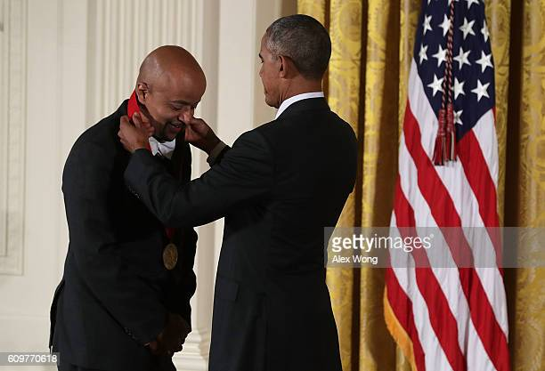 S President Barack Obama presents the National Humanities Medal to author James McBride during an East Room ceremony at the White House September 22...