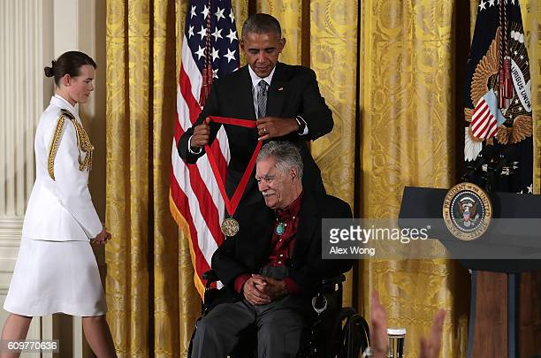 S President Barack Obama presents the National Humanities Medal to author Rudolfo Anaya during an East Room ceremony at the White House September 22...