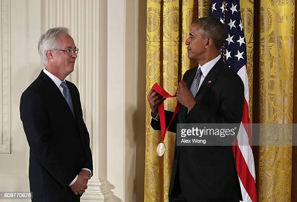 S President Barack Obama presents the National Humanities Medal to author Louis Menand during an East Room ceremony at the White House September 22...