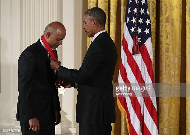 S President Barack Obama presents the National Humanities Medal to physician Abraham Verghese during an East Room ceremony at the White House...