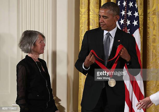 President Barack Obama presents the National Humanities Medal to poet Louise Gluck during an East Room ceremony at the White House September 22, 2016...