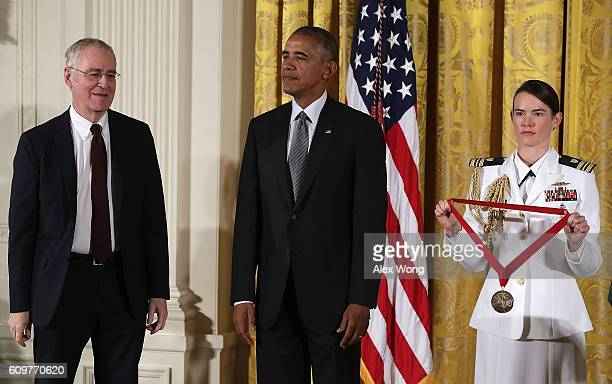 S President Barack Obama presents the National Humanities Medal to author Ron Chernow during an East Room ceremony at the White House September 22...