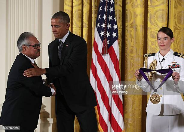 S President Barack Obama presents the National Medal of Arts playwright and film director Luis Valdez during an East Room ceremony at the White House...