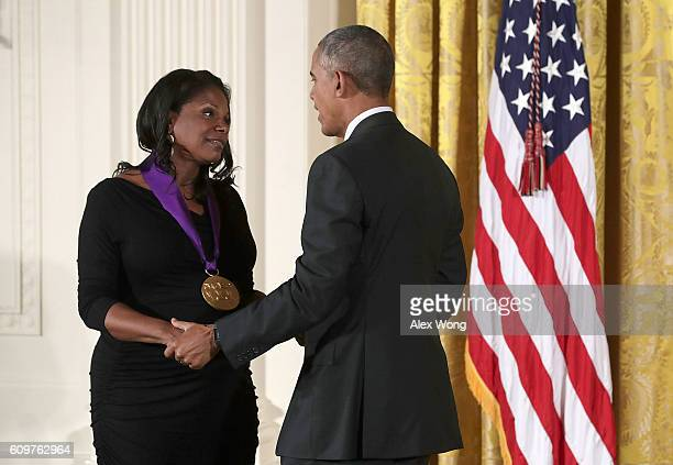 S President Barack Obama presents the National Medal of Arts to actress and singer Audra McDonald during an East Room ceremony at the White House...