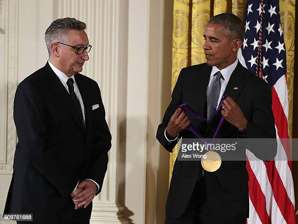 S President Barack Obama presents the National Medal of Arts to director and playwright Moises Kaufman during an East Room ceremony at the White...