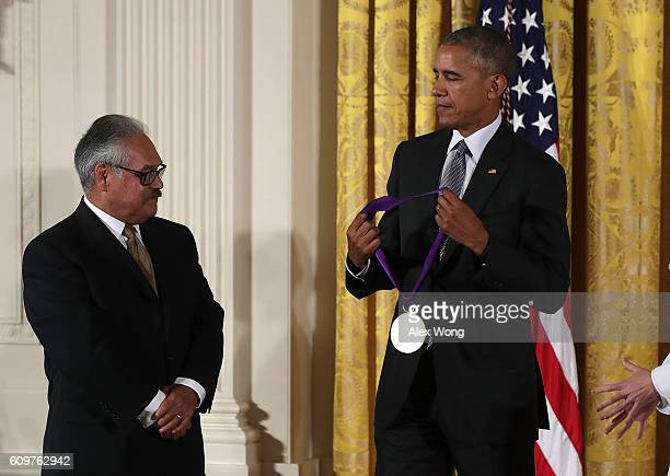 S President Barack Obama presents the National Medal of Arts to playwright and film director Luis Valdez during an East Room ceremony at the White...